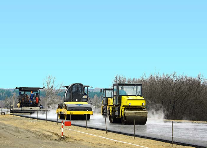 asphalt trucks paving highway fort worth